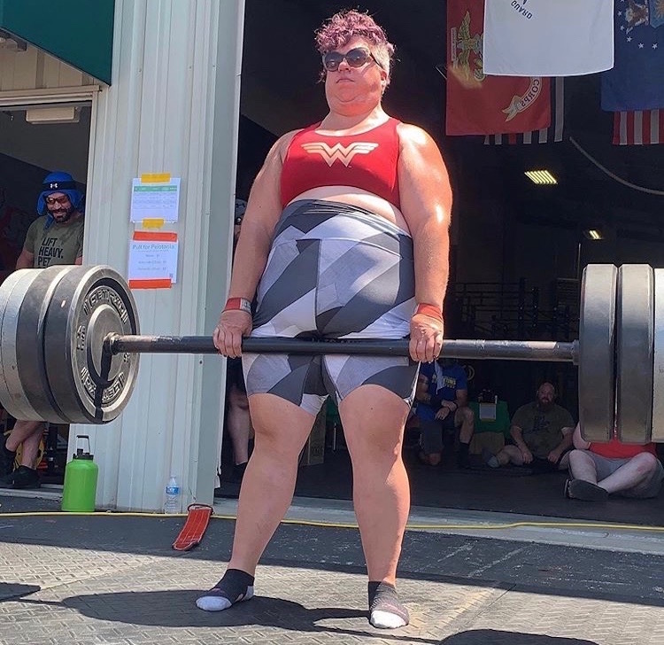 Photo of woman lifting weights